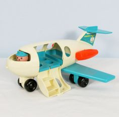 Vintage 1970s FISHER PRICE AIRPLANE Toy.  I had this and the airport.  I sure wish I still had all my Fisher Price toys I grew up with!!