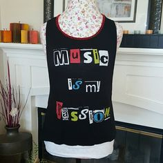 """Trendy Muscle Tee """"Music is My Passion"""" muscle tee. Super cute! I paired it with a white cami underneath (not included) or pair with your favorite bandeau and cutoff shorts! Happy Poshing!! Tops Muscle Tees"""