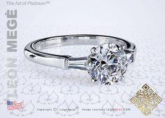 Round diamond three stone engagement ring by Leon Megé