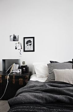 It's hard to make black, grey and white look warm & inviting.  i could get cozy in that bed with a big mug of coffee and some magazines. i'm also crazy for the trunk as a side 'table'