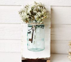 Vintage Jar Vase. I should use some of the wood from my grandparents old barn and some of their old blue canning jars to make some of these. Super cute!