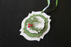 handmade Christmas Tag ... three popped layers of labels die cuts .. punch foliage and berries ... great tag ... could be a card topper ... like it!!
