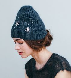 The rich graphite color of this Jennifer Behr Snowflake and Scattered Crystal Hat adds an edgy vibe to an otherwise dainty Swarovski, silk and wool beanie.