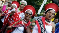 A group of Zulu traditionally clad women march through the streets of Durban to celebrate Africa Day on 23 May 2015