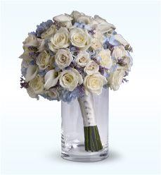 winter wedding flowers  ROSES, TULIPS, HYDRANGEA, AMARYLLIS, LILIES, ORCHIDS, STEPHANOTIS, IVY, EVERGREENS