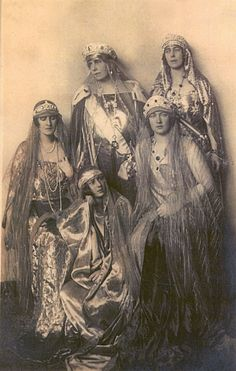 Queen Marie of Romania, wearing the sapphire kokoshnic of Grand Duchess Vladimir, with her daughters, who have a nice collection of tiaras between them.