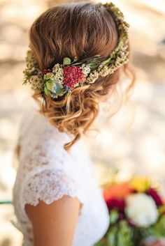 Pretty flower crown and low side bun wedding hairstyle