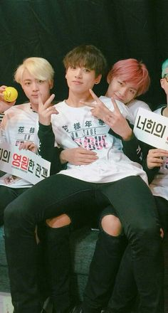 VKOOK!!!! 2016 THERE IS VKOOK RIGHT THERE!! JUNGKOOK IS SITTING IN V'S LAP, V HAS HIS ARM WRAPPED AROUND HIS WAIST!!! DO YOU NOT SEE IT!???