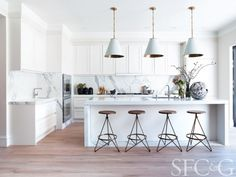 Amazing white kitchen with marble backsplash, hardwood flooring, island. #Gaggenau #Liebherr #NYC&G