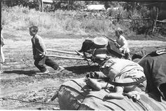 Refugee children pulling a cart. Eastern front, sometime in 1941-1945. [590x397]