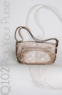 Coach - Perforated Leather Duffle.  Go to wkrq.com to find out how to play Q102's Pick Your Purse!