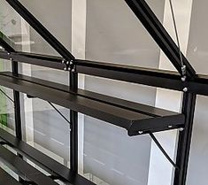 Halls x Qube Greenhouse with black frame and toughened glazing. Buy greenhouse, accessories and installation at great prices online now! Buy Greenhouse, Home And Garden, Shelves, Store, Home Decor, Shelving, Homemade Home Decor, Tent, Shop Local