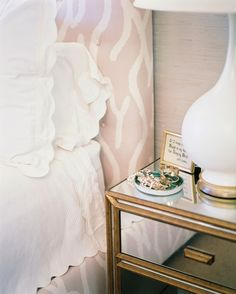 Pretty headboard  linens plus bedside table!