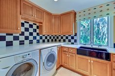42 Marsh Creek laundry room with blue farm sink