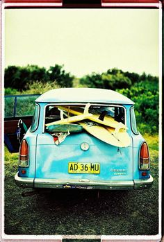 the Sea-Farer. vintage car with surfboards.. on the way to catch the waves