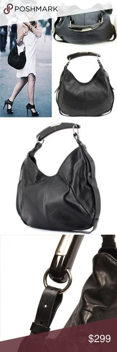 YSL Iconic Mombasa Ford black leather horn hobo This piece is so gorgeous! A few only to be found of the all black bag and horn handle from Tom Fords coveted Rive Gauche days.. Its the Mombasa hobo from Saint Laurent which features the iconic horn style top handle with silver hardware. Designed with a slouch silhouette in a supple black leather. A magnetic snap top closure opens up to a spacious interior which can hold your day to night essentials comfortably. Interior zippered pocket. Yves…