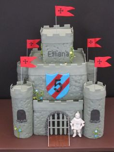 Medieval Castle Birthday Cake - A Medieval Castle cake for a five year old little girl. The knight is made out of gumpaste.