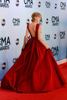 Taylor Swift stuns in a red Elie Saab ball gown and matching lipstick, staying true to the title of her hit album 'Red'
