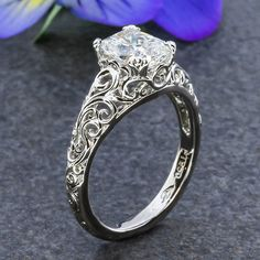 Scrolls & Swirls are simply lovely! Custom piece example for Tate. Emerald cut diamond or green MT Sapphire