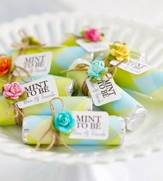Use decorative vintage gray scrapbook paper, thin silver ribbon, white tag and pink rose.   Mint to be, wedding favors...this is cute And im sure would be relatively cheap to make?
