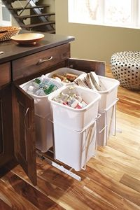 Divide trash and recyclables quickly and easily with a roll out recycling cabinet housing a pair of bins.