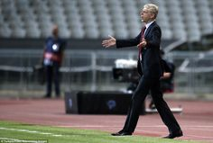 Flabbergasted: Arsenal boss Arsene Wenger couldn't believe the decision given against his ...