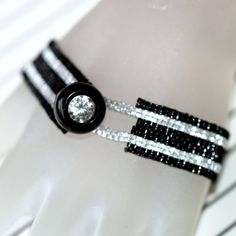 Sexy Silver Stripe...  Diminutive peyote bracelet in black and silver, with a vintage rhinestone button closure.  $32