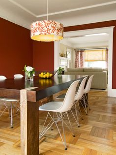 A rich, brick-red color surrounds this cozy dining table. Design by Jennifer Jones.