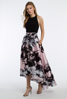 This unique prom dress is super sophisticated for formal! The floral skirt, tie waist back, high-low skirt, and side pockets on this evening dress give it a modern look. #CLVprom17 #camillelavie
