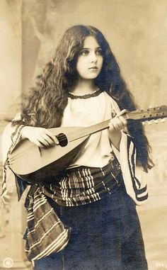 Little gypsy girl with mandolin ca. 1910.