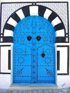 Sidi Bou Said, Tunis, Tunisia  (been there :) They paint them blue because it's a symbol of luck, prosperity and happiness.