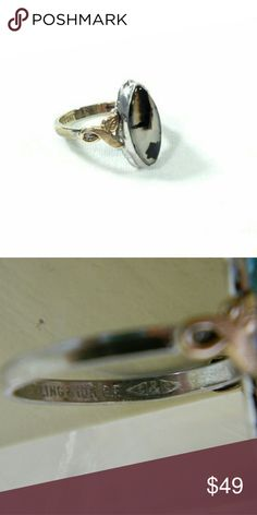 "Vintage Gold Sterling Clark and Coombs Ring Clark and Coombs agate stone sterling and 10K gold filled ring.   Age: estimated circa 1930's - 40's   Hallmarks: it is marked sterling 10K GF. It is also marked with two C's inside triangles back to back, which is the hallmark for Clark and Coombs.   Measurements: the band is a size 6.5. The stone is approximately 7/8"" tall x 1/4"" wide.  Vintage Jewelry Rings"