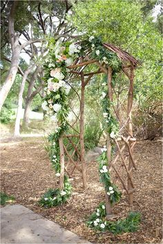 Wooden arch with florals and greenery