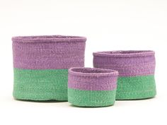 The Asubuhi colour block baskets boast bands of deep green and purple – a creative juxtaposition of colour that will bring joy to every corner of the home. Produced in three sizes, these baskets can be used as indoor planters or flower pots, and can be used for storing all manner of household bits and bobs: slippers and blankets, remotes and cables, knitting, soft toys – the list is endless. FAIR TRADE & HANDMADE IN KENYA These baskets are handwoven by a small collective of female weavers li Rainbow Bedroom, Rainbow Nursery, Sisal, Afrika Shop, Basket Weaving, Hand Weaving, Pot Storage, Storage Baskets, Colourful Living Room