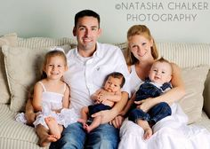 Family of Five on the Couch with Newborn