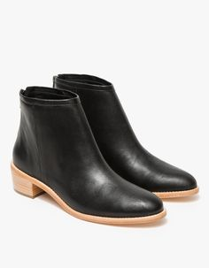 From Loeffler Randal, a classic textured calf leather ankle bootie in black. Features rounded toe, silver zipper back, cuff detail, fully lined, leather uppers, leather insole, leather outsole, stacked heel and welted leather sole.  •Ankle bootie in bl