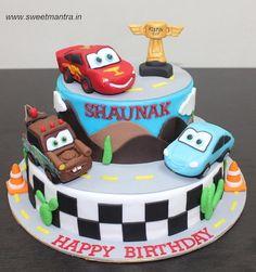 Disney Pixar Cars Lightning McQueen theme customized 2 layer designer fondant cake by Sweet Mantra - Customized 3D cakes Designer Wedding/Engagement cakes in Pune - http://cakesdecor.com/cakes/281761-disney-pixar-cars-lightning-mcqueen-theme-customized-2-layer-designer-fondant-cake