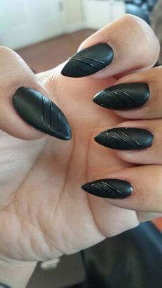 Matte black pointy nails by Julie