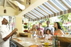 Enjoy delicious pizza as you stroll through the Caribbean Village! | Beaches Resorts | Turks & Caicos #BeachesMoms