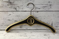Vintage Solid Wood Hanger Hollywood Regency Style Black & Gold Painted Body Metal Hook and Circle Detail Great for Coats Letter Initial G by BrooklynBornFinds on Etsy