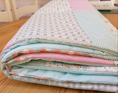 Check out this item in my Etsy shop https://www.etsy.com/uk/listing/592137747/baby-girls-cot-quilt-in-pink-and-mint