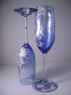 WOW looking Wedding champagne glasses in royal blue and pearl, perfect for winter wedding or as a Christmas eve table glassware.