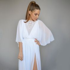 At $677 NZD this stunningkimono style wedding dressis a BARGAIN! Designed and handmadeby 5 Star Etsy store Barzelai, this dress is elegant yet alternative with a plunge neckline and thigh level split adding the wow (a.k.a hubba hubba) factor, and sleeves perfect for a bride who wants to hide her goodbye dorothy's (less than toned ...
