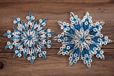 close up of a snowflake out of paper quilling technique against the background of the old cracked bo Stock Photo
