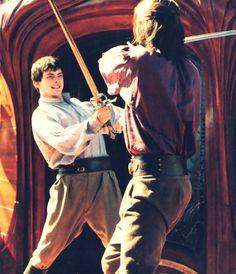 Ed and Caspian having a friendly spar on the deck of the Dawn Treader, as boys do on ships.