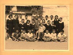 A B/W photo of a school class. Greece, twentieth century. Courtesy Peloponnesian Folklore Foundation, all rights reserved.