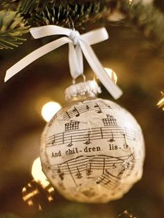Maybe put a cute/small tree with music ornaments on the piano? Can't get enough holiday music? Photocopy sheet music from favorite Christmas carols and decoupage onto glass ornaments Easy Christmas Ornaments, Frugal Christmas, Noel Christmas, Outdoor Christmas Decorations, Christmas Centerpieces, Rustic Christmas, Simple Christmas, Holiday Crafts, Homemade Christmas