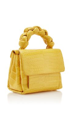 This cross body bag by Nancy Gonzales is rendered in crocodile skin and…