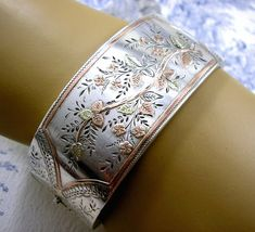 Beautiful piece of Antique Victorian Jewelry dating from circa 1890. Romantic Antique Aesthetic Era Silver Cuff Bangle with Trailing Wild Roses.