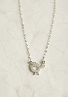 Tiny Tweet Bird Necklace:  A darling addition to any outfit, this silver-toned necklace features an adorable bird pendant